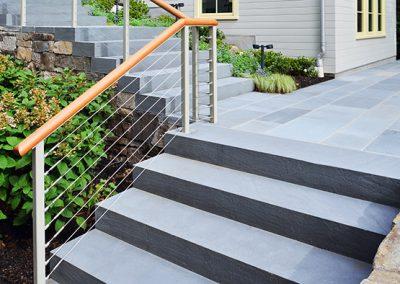 Saw cut black granite in landscaping application including walking steps and landing.