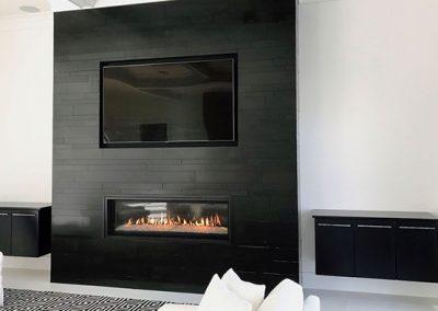 Black granite fireplace.
