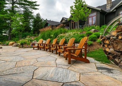 Landscaped flagstone to provide a level sitting area outdoors.