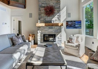 Large scale floor to ceiling fireplace to create a warm and cozy residential design.